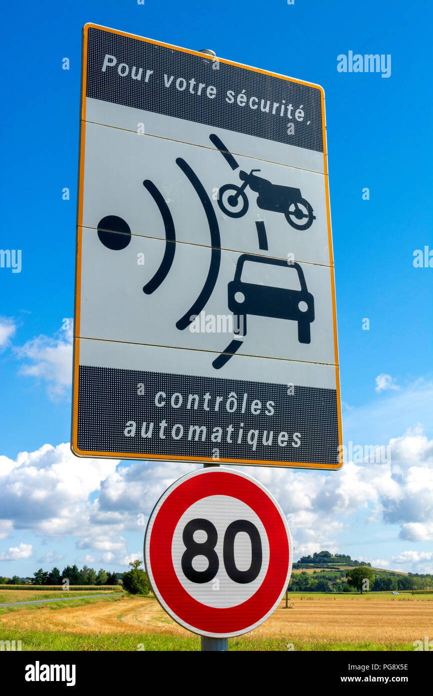 Sign of speed limit  reduced to 80 km/hour and radar speed check, France - Stock Image