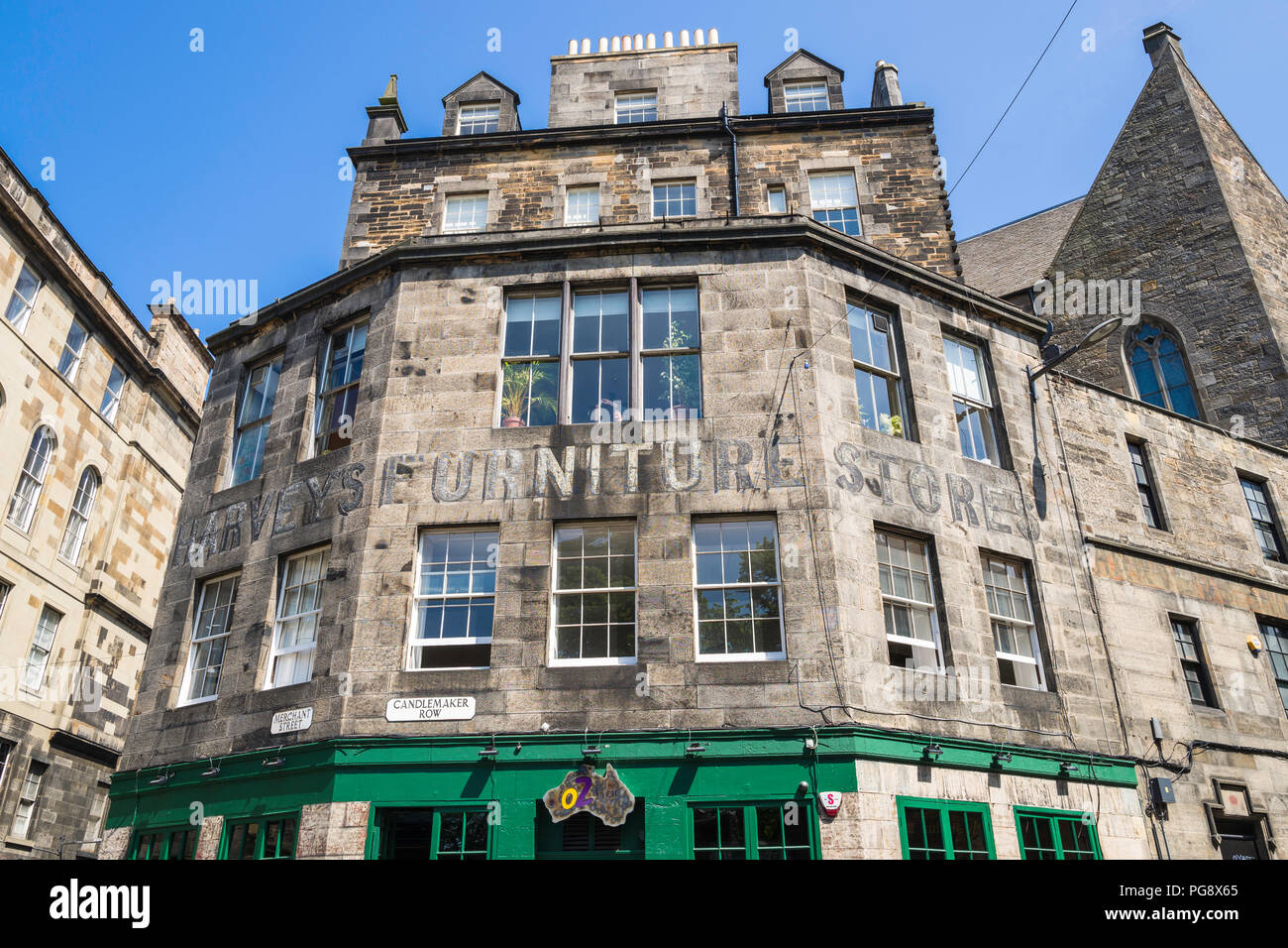 The former Harvey's Furniture Stores in Candlemaker Row, Edinburgh, Scotland, is now a popular Australian bar. Stock Photo