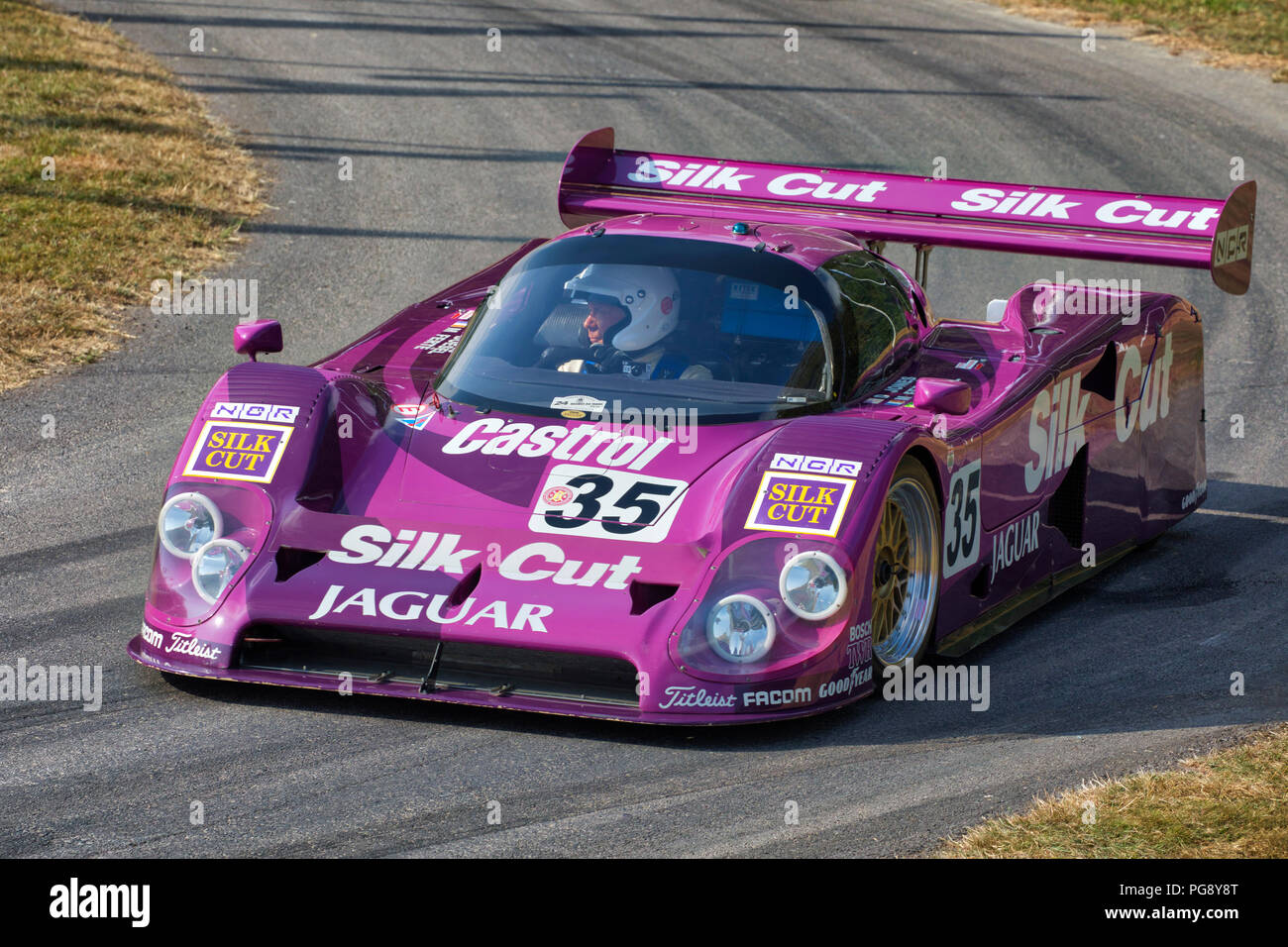 1988 Silk Cut Jaguar XJR-9 LM Le Mans endurance racer with driver Gary Pearson at the 2018 Goodwood Festival of Speed, Sussex, UK. - Stock Image