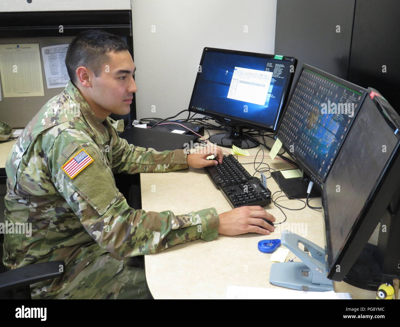 US Army Reserve 1st Lt. Michael Pernell reviews personnel files during the 211th RSG's monthly weekend drill on August 19, 2018, at Corpus Christi, Texas. 1st Pernell is a Human Resources Officer and personnel strength manager with the 211th Regional Support Group (RSG) based out of Corpus Christi, Texas. Citizen-soldiers like 1st Lt. Pernell have a wide variety of skill sets which ensure America's Army Reserve units are trained to deploy bringing capable, combat-ready, and lethal firepower in support of the Army and our joint partners anywhere in the world. - Stock Image