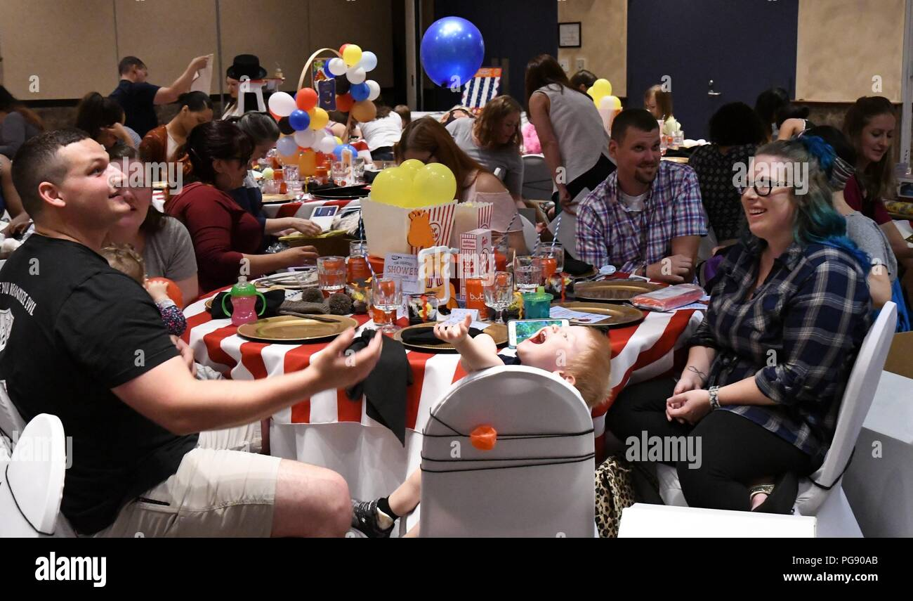 """The Commons ballroom was decorated in a circus theme Aug. 22 as 39 expectant mothers at Fort Drum were invited to an exclusive baby shower. Hosted by the non-profit Operation Shower with the theme """"The Greatest Shower on Earth,"""" attendees were treated to a pasta and pizza lunch, shower games, raffles and more. (Photo by Mike Strasser, Fort Drum Garrison Public Affairs) Stock Photo"""