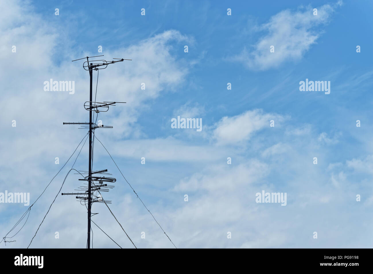 Television aerial against cloudy sky. Komsomolsk-on-Amur, Russia - Stock Image