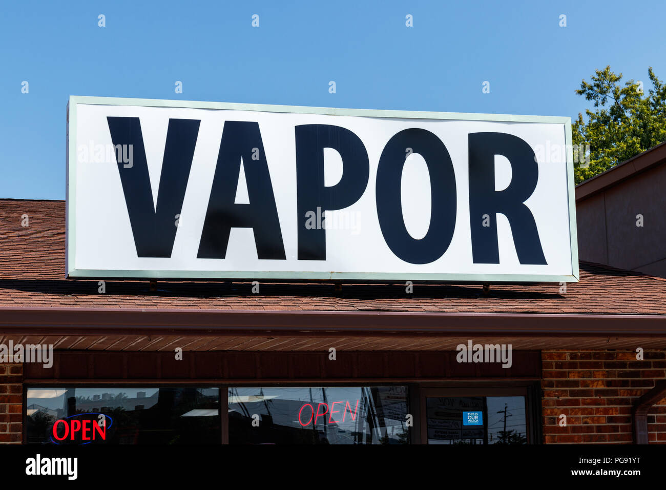 Indianapolis - Circa August 2018: Vapor sign over a vape shop. The benefits of vaping as a way to quit smoking far outweigh the health risks I - Stock Image
