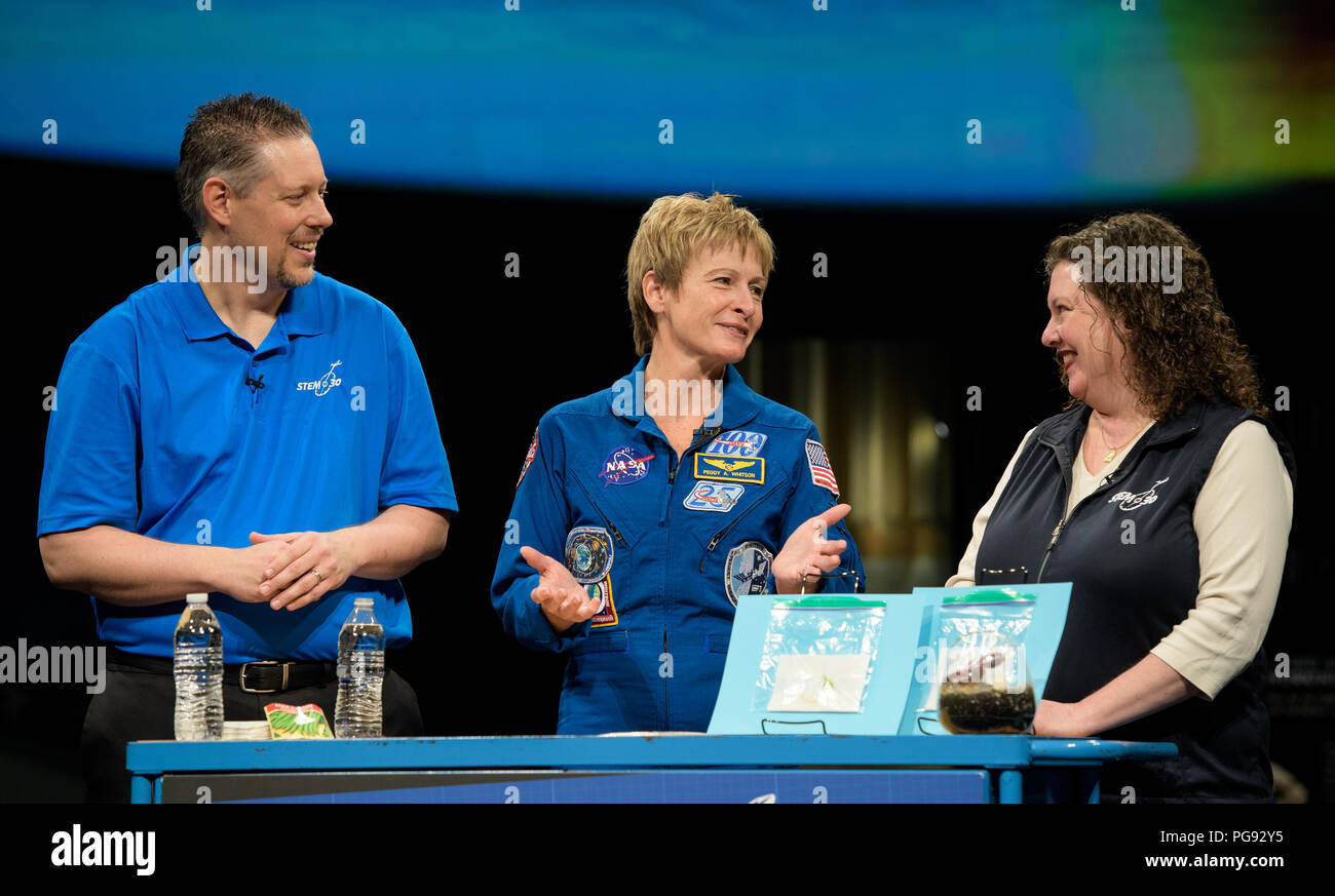 NASA astronaut Peggy Whitson tapes a segment for STEM in 30 with Marty Kelsey, left, and Beth Wilson, Friday, March 2, 2018 at the Smithsonian's National Air and Space Museum in Washington. Whitson spent 288 days onboard the International Space Station as a member of Expedition 50, 51, and 52, conducting four spacewalks and contributing to hundreds of experiments in biology, biotechnology, physical science and Earth science during her stay. - Stock Image