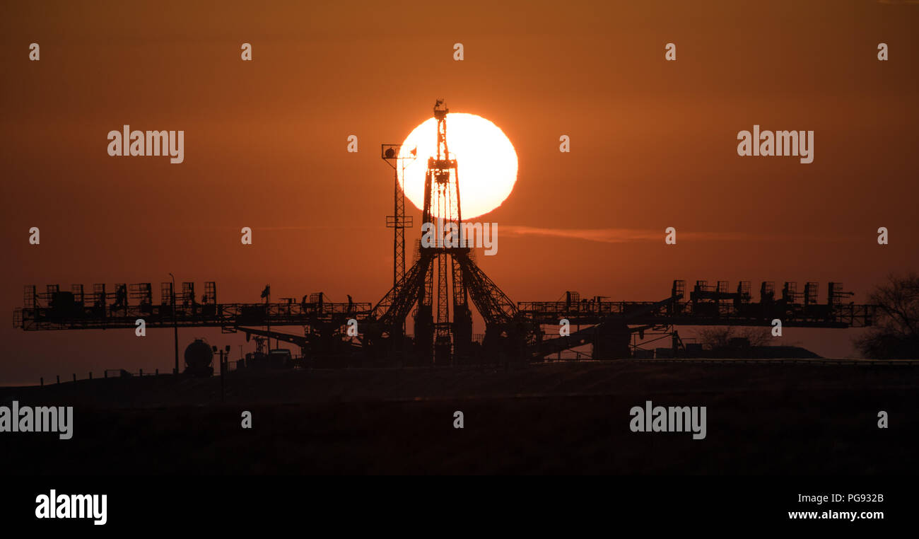 The Sun is seen rising behind the launch pad, Monday, March 19, 2018 at the Baikonur Cosmodrome in Kazakhstan. Expedition 55 crewmembers Ricky Arnold and Drew Feustel of NASA and Oleg Artemyev of Roscosmos are scheduled to launch at 1:44 p.m. Eastern time (11:44 p.m. Baikonur time) on March 21 and will spend the next five months living and working aboard the International Space Station. Stock Photo