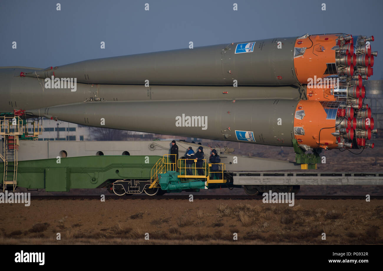 The Soyuz rocket is rolled out by train to the launch pad, Monday, March 19, 2018 at the Baikonur Cosmodrome in Kazakhstan. Expedition 55 crewmembers Ricky Arnold and Drew Feustel of NASA and Oleg Artemyev of Roscosmos are scheduled to launch at 1:44 p.m. Eastern time (11:44 p.m. Baikonur time) on March 21 and will spend the next five months living and working aboard the International Space Station. - Stock Image