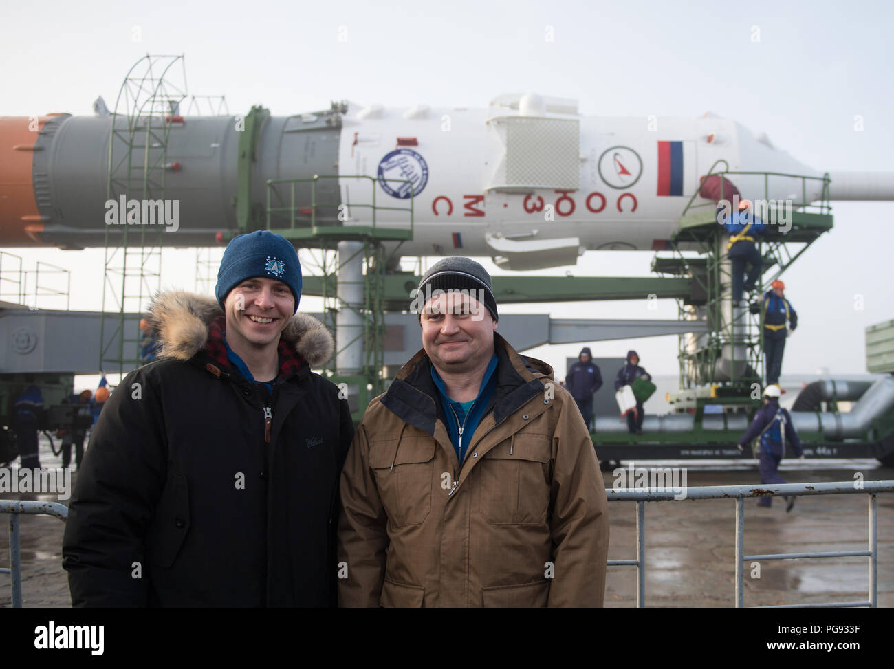 Expedition 55 backup crewmembers Nick Hague of NASA, left, and Alexey Ovchinin of Roscosmos pose for a picture as the Soyuz rocket is rolled out to the pad, Monday, March 19, 2018 at the Baikonur Cosmodrome in Kazakhstan. Expedition 55 crewmembers Ricky Arnold and Drew Feustel of NASA and Oleg Artemyev of Roscosmos are scheduled to launch at 1:44 p.m. Eastern time (11:44 p.m. Baikonur time) on March 21 and will spend the next five months living and working aboard the International Space Station. - Stock Image