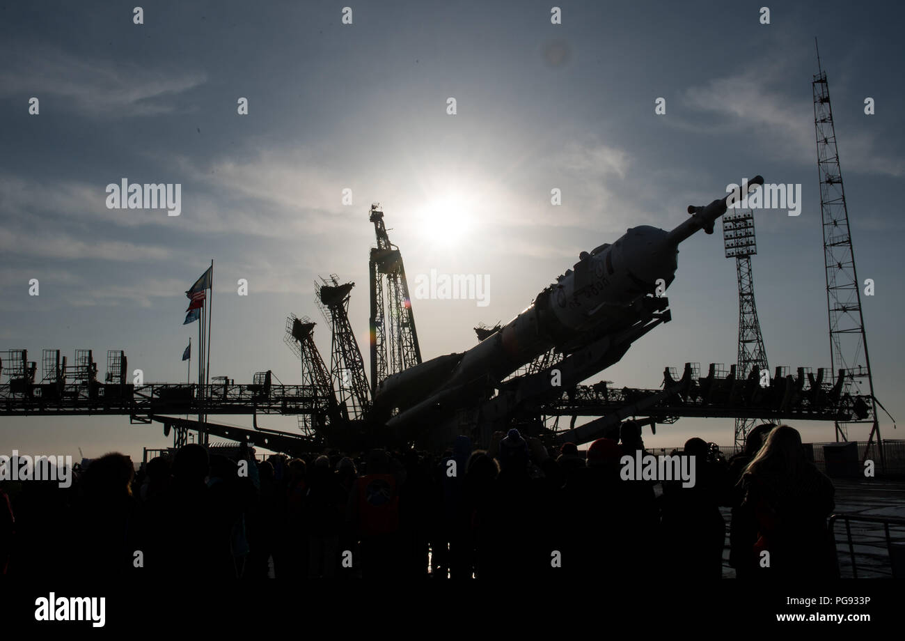 The Soyuz rocket is raised into a vertical position on the launch pad, Monday, March 19, 2018 at the Baikonur Cosmodrome in Kazakhstan. Expedition 55 crewmembers Ricky Arnold and Drew Feustel of NASA and Oleg Artemyev of Roscosmos are scheduled to launch at 1:44 p.m. Eastern time (11:44 p.m. Baikonur time) on March 21 and will spend the next five months living and working aboard the International Space Station. - Stock Image