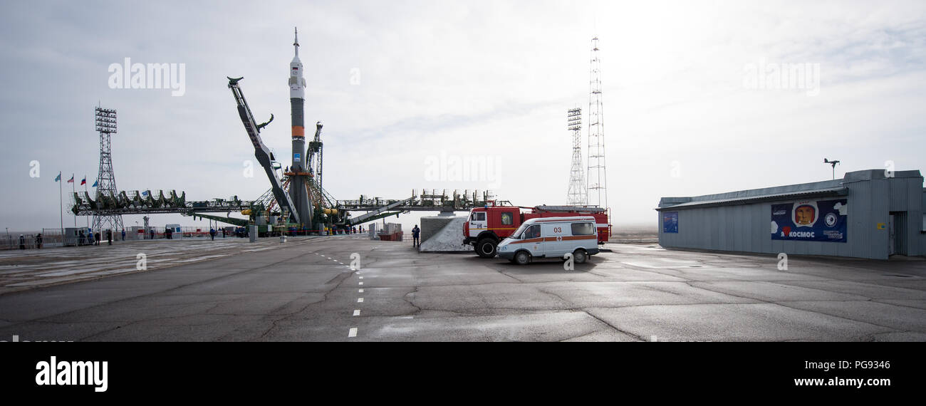 The Soyuz rocket is seen on the launch pad after being raised into a vertical position, Monday, March 19, 2018 at the Baikonur Cosmodrome in Kazakhstan. Expedition 55 crewmembers Ricky Arnold and Drew Feustel of NASA and Oleg Artemyev of Roscosmos are scheduled to launch at 1:44 p.m. Eastern time (11:44 p.m. Baikonur time) on March 21 and will spend the next five months living and working aboard the International Space Station. - Stock Image