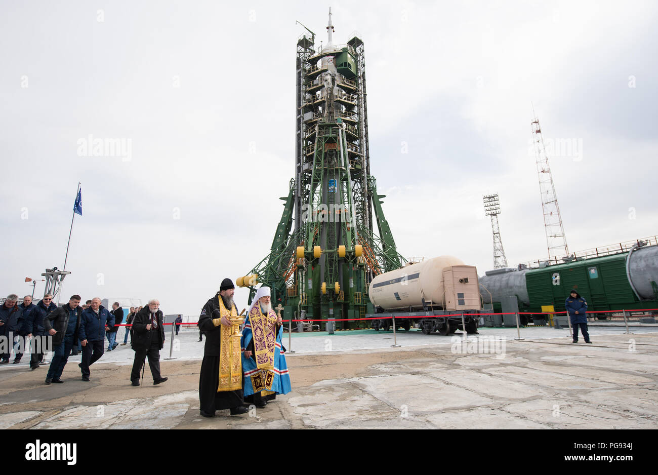 A pair of Orthodox Priests are seen after blessing the Soyuz rocket at the Baikonur Cosmodrome launch pad, Tuesday, March 20, 2018 in Baikonur, Kazakhstan. Expedition 55 Soyuz Commander Oleg Artemyev of Roscosmos, Ricky Arnold and Drew Feustel of NASA are scheduled to launch to the International Space Station aboard the Soyuz MS-08 spacecraft on Wednesday, March, 21. - Stock Image