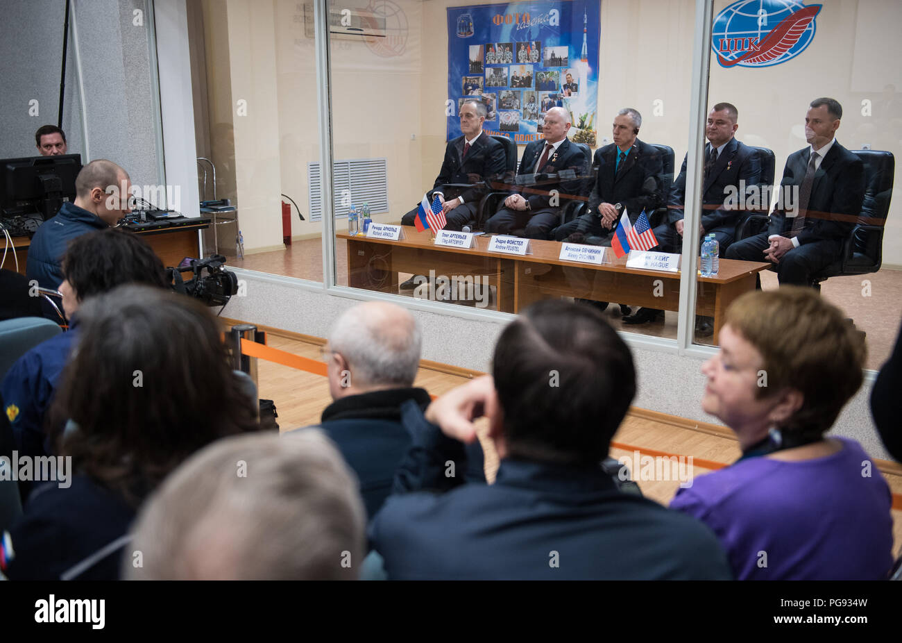 Expedition 55 prime crew members Ricky Arnold of NASA, left, Oleg Artemyev of Roscosmos, second from left, and Drew Feustel of NASA, center, are seen with backup crew members Alexey Ovchinin of Roscosmos, second from right, and Nick Hague of NASA, right, during the State Commission meeting to approve the Soyuz launch of Expedition 55 to the International Space Station, Tuesday, March 20, 2018. Arnold, Artemyev, and Feustel are scheduled to launch to the International Space Station aboard the Soyuz MS-08 spacecraft on Wednesday, March, 21. - Stock Image