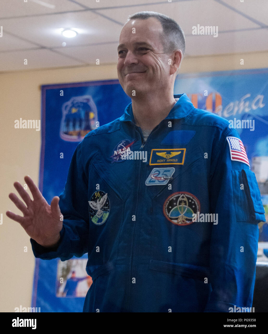 Expedition 55 flight engineer Ricky Arnold is seen in quarantine, behind glass, during a press conference, Tuesday, March 20, 2018 at the Cosmonaut Hotel in Baikonur, Kazakhstan. Arnold and his fellow Expedition 55 crew members Oleg Artemyev of Roscosmos and flight engineer Drew Feustel of NASA are scheduled to launch to the International Space Station aboard the Soyuz MS-08 spacecraft on Wednesday, March, 21. - Stock Image