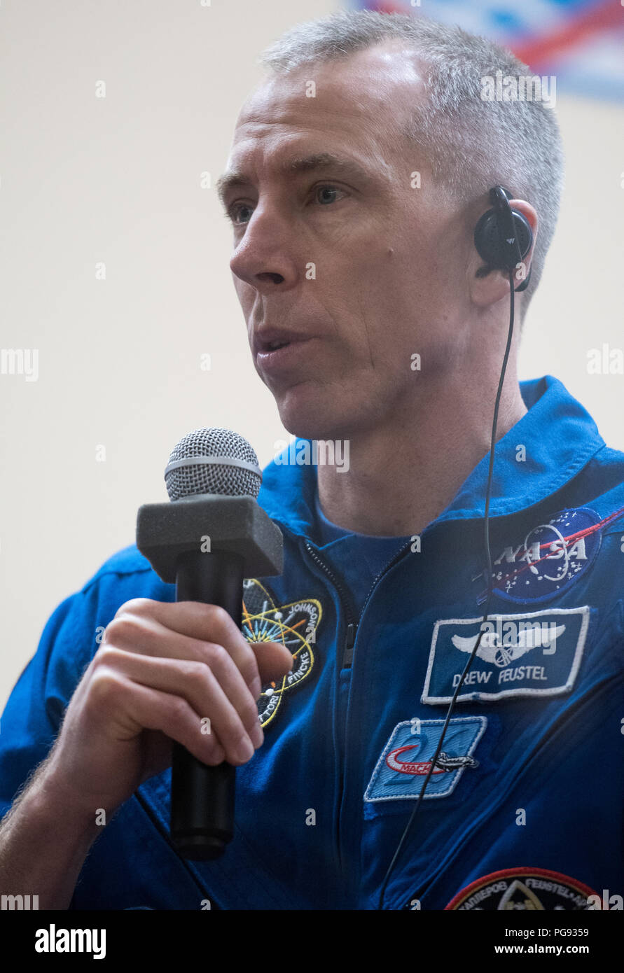 Expedition 55 flight engineer Drew Feustel of NASA answers a question during a press conference, Tuesday, March 20, 2018 at the Cosmonaut Hotel in Baikonur, Kazakhstan. Feustel, Soyuz Commander Oleg Artemyev of Roscosmos, and flight engineer Ricky Arnold of NASA are scheduled to launch to the International Space Station aboard the Soyuz MS-08 spacecraft on Wednesday, March, 21. - Stock Image