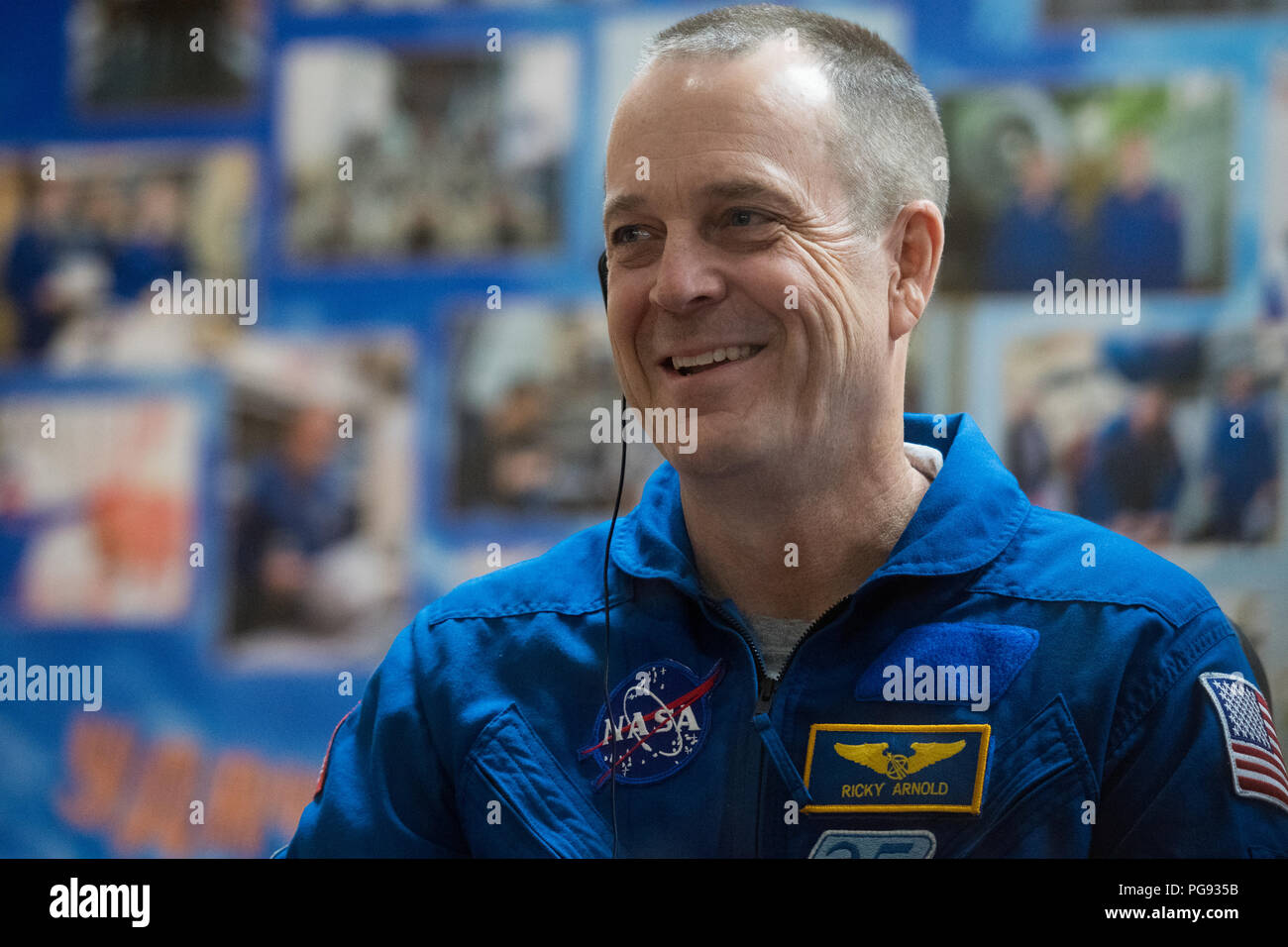 Expedition 55 flight engineer Ricky Arnold of NASA is seen in quarantine, behind glass, during a press conference, Tuesday, March 20, 2018 at the Cosmonaut Hotel in Baikonur, Kazakhstan. Arnold, Soyuz Commander Oleg Artemyev of Roscosmos, flight engineer Drew Feustel of NASA are scheduled to launch to the International Space Station aboard the Soyuz MS-08 spacecraft on Wednesday, March, 21. - Stock Image