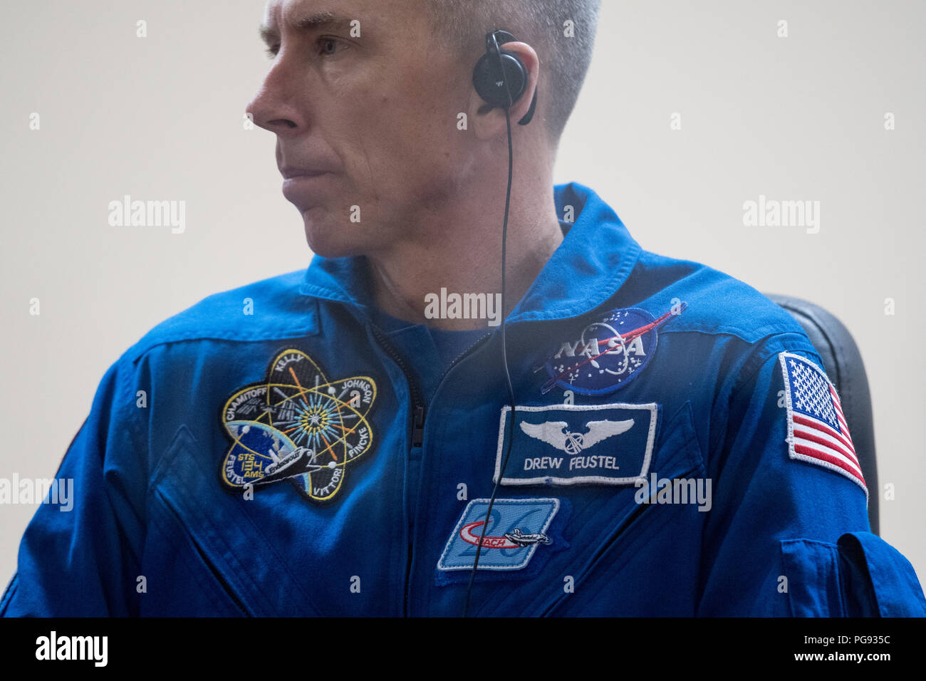 Expedition 55 flight engineer Drew Feustel of NASA is seen in quarantine, behind glass, during a press conference, Tuesday, March 20, 2018 at the Cosmonaut Hotel in Baikonur, Kazakhstan.  Feustel, Oleg Artemyev of Roscosmos, and flight engineer Ricky Arnold of NASA are scheduled to launch to the International Space Station aboard the Soyuz MS-08 spacecraft on Wednesday, March, 21. Stock Photo