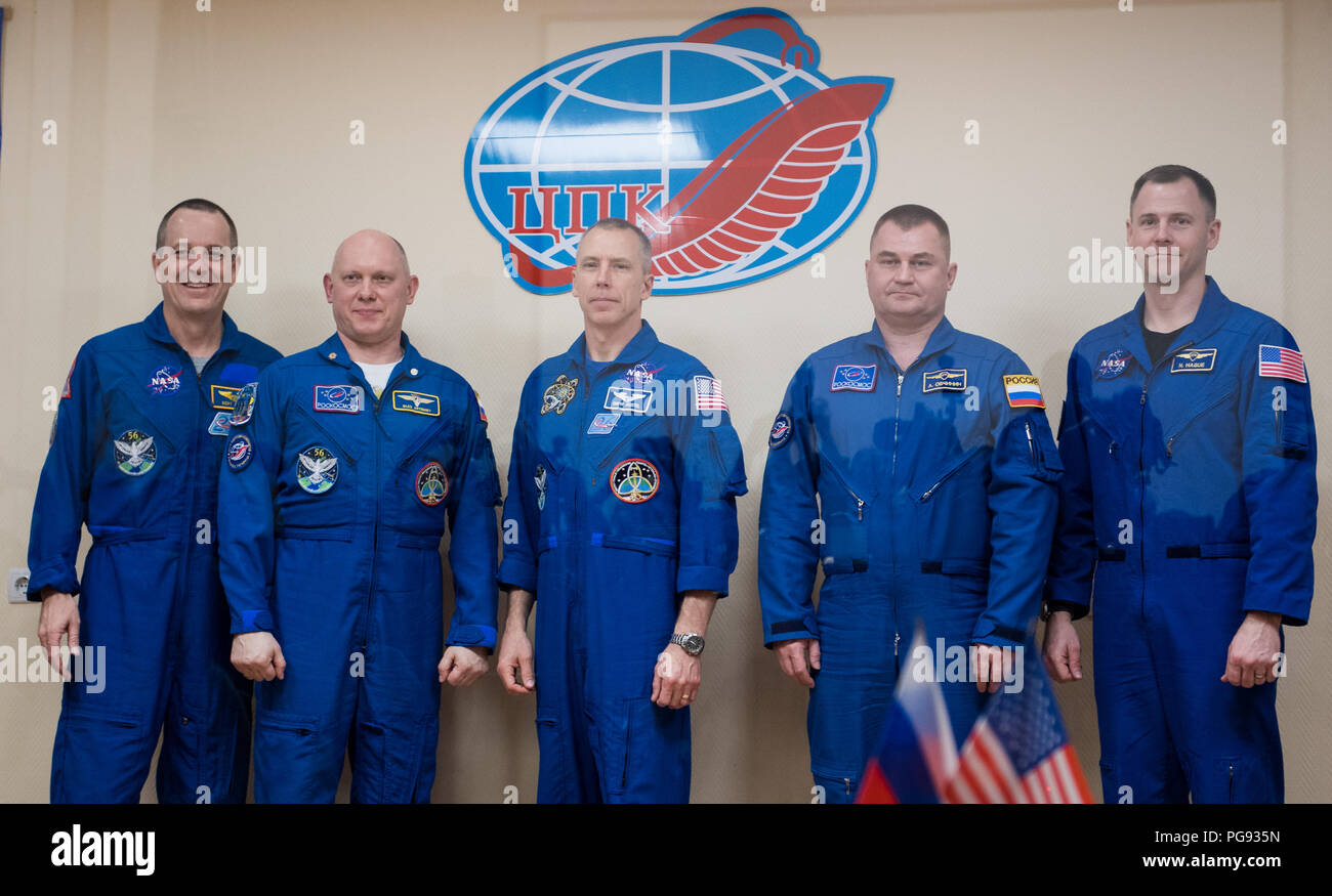 Expedition 55 prime crew members Ricky Arnold of NASA, left, Oleg Artemyev of Roscosmos, second from left, and Drew Feustel of NASA, center, pose for a picture with backup crew members Alexey Ovchinin of Roscosmos, second from right, and Nick Hague of NASA, right, at the conclusion of a press conference, Tuesday, March 20, 2018 at the Cosmonaut Hotel in Baikonur, Kazakhstan. Arnold, Artemyev, and Feustel are scheduled to launch to the International Space Station aboard the Soyuz MS-08 spacecraft on Wednesday, March, 21. - Stock Image