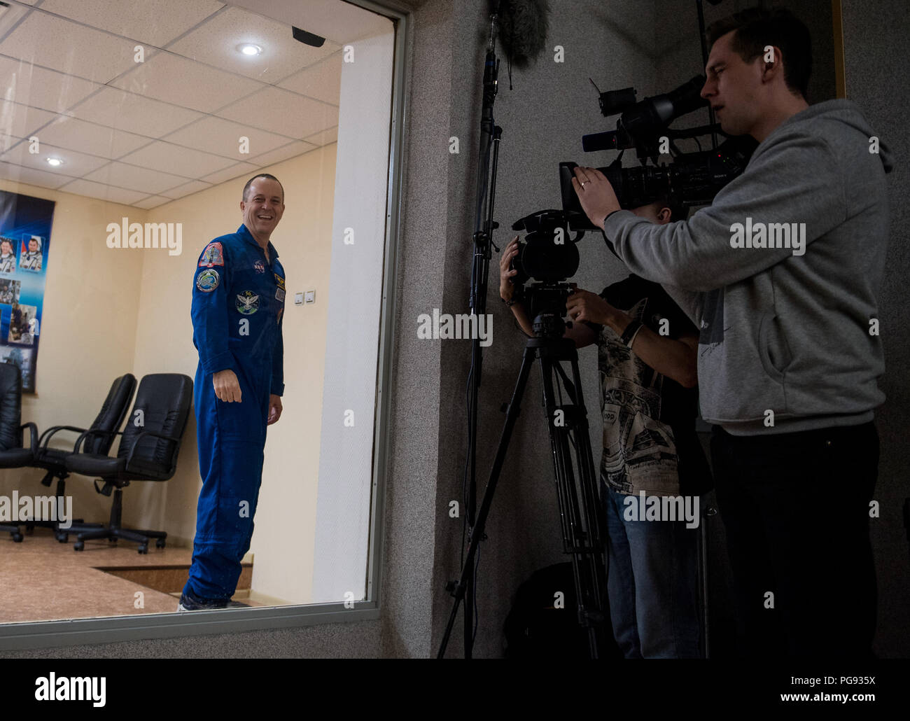 Expedition 55 flight engineer Ricky Arnold of NASA is seen at the conclusion of a press conference, Tuesday, March 20, 2018 at the Cosmonaut Hotel in Baikonur, Kazakhstan. Arnold, Soyuz Commander Oleg Artemyev of Roscosmos, and flight engineer Drew Feustel of NASA are scheduled to launch to the International Space Station aboard the Soyuz MS-08 spacecraft on Wednesday, March, 21. - Stock Image