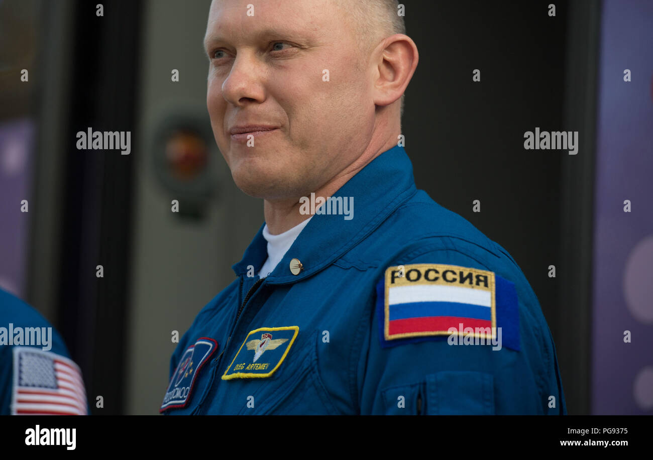 Expedition 55 Soyuz Commander Oleg Artemyev of Roscosmos is seen as he and fellow crewmates Ricky Arnold and Drew Feustel of NASA depart the Cosmonaut Hotel to suit-up for their Soyuz launch to the International Space Station, Wednesday, March 21, 2018 in Baikonur, Kazakhstan. Arnold, Artemyev, and Feustel launched aboard the Soyuz MS-08 spacecraft at 1:44 p.m. Eastern time (11:44 p.m. Baikonur time) on March 21 to begin their journey to the International Space Station. - Stock Image
