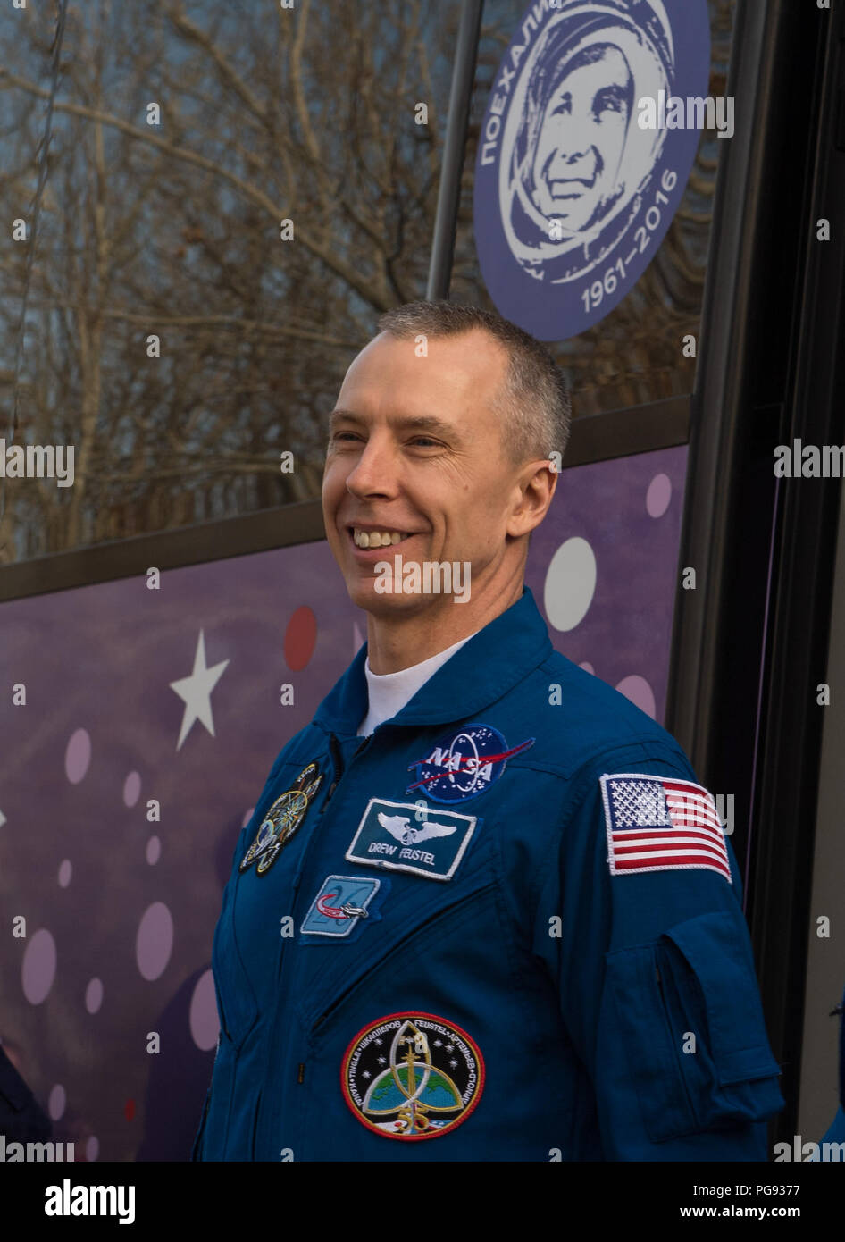 Expedition 55 Soyuz flight engineer Drew Feustel of NASA is seen as he and fellow crewmates Oleg Artemyev of Roscosmos and Ricky Arnold of NASA depart the Cosmonaut Hotel to suit-up for their Soyuz launch to the International Space Station, Wednesday, March 21, 2018 in Baikonur, Kazakhstan. Arnold, Artemyev, and Feustel launched aboard the Soyuz MS-08 spacecraft at 1:44 p.m. Eastern time (11:44 p.m. Baikonur time) on March 21 to begin their journey to the International Space Station. - Stock Image