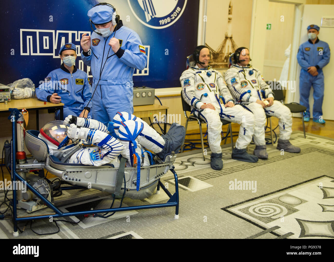 Expedition 55 flight engineer Drew Feustel of NASA prepares to have his Russian Sokol suit pressure checked in preparation for launch aboard the Soyuz MS-08 spacecraft, Wednesday, March 21, 2018 at the Baikonur Cosmodrome  Kazakhstan. Feustel, Soyuz Commander Oleg Artemyev of Roscosmos, and flight engineer Ricky Arnold of NASA launched aboard the Soyuz MS-08 spacecraft at 1:44 p.m. Eastern time (11:44 p.m. Baikonur time) on March 21 to begin their journey to the International Space Station. - Stock Image