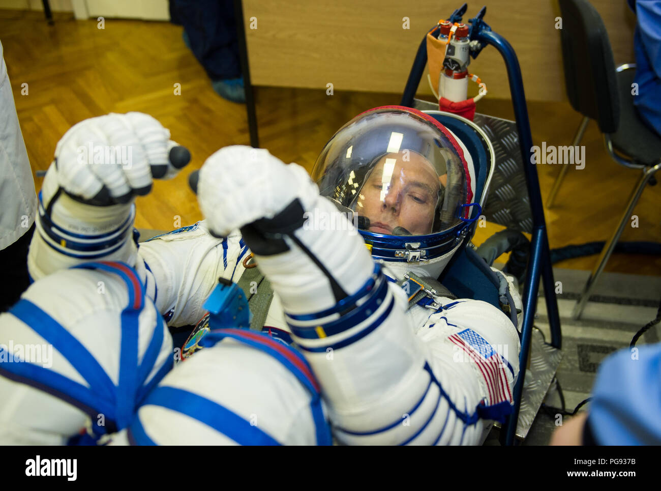 Expedition 55 flight engineer Drew Feustel of NASA has his Russian Sokol suit pressure checked in preparation for launch aboard the Soyuz MS-08 spacecraft, Wednesday, March 21, 2018 at the Baikonur Cosmodrome  Kazakhstan. Feustel, Soyuz Commander Oleg Artemyev of Roscosmos, and flight engineer Ricky Arnold of NASA launched aboard the Soyuz MS-08 spacecraft at 1:44 p.m. Eastern time (11:44 p.m. Baikonur time) on March 21 to begin their journey to the International Space Station. - Stock Image