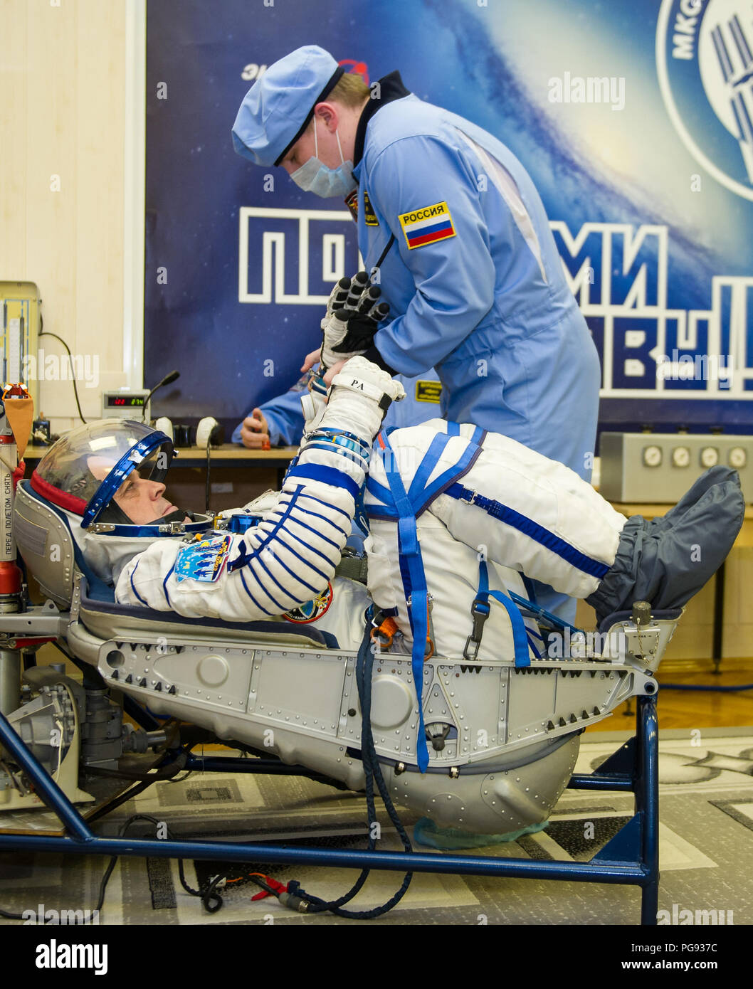 Expedition 55 flight engineer Ricky Arnold of NASA prepares to have his Russian Sokol suit pressure checked in preparation for launch aboard the Soyuz MS-08 spacecraft, Wednesday, March 21, 2018 at the Baikonur Cosmodrome  Kazakhstan. Arnold, Soyuz Commander Oleg Artemyev of Roscosmos, and flight engineer Drew Feustel of NASA launched aboard the Soyuz MS-08 spacecraft at 1:44 p.m. Eastern time (11:44 p.m. Baikonur time) on March 21 to begin their journey to the International Space Station. - Stock Image