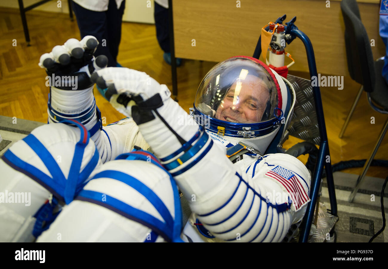 Expedition 55 flight engineer Ricky Arnold of NASA has his Russian Sokol suit pressure checked in preparation for launch aboard the Soyuz MS-08 spacecraft, Wednesday, March 21, 2018 at the Baikonur Cosmodrome  Kazakhstan. Arnold, Soyuz Commander Oleg Artemyev of Roscosmos, and flight engineer Drew Feustel of NASA launched aboard the Soyuz MS-08 spacecraft at 1:44 p.m. Eastern time (11:44 p.m. Baikonur time) on March 21 to begin their journey to the International Space Station. - Stock Image