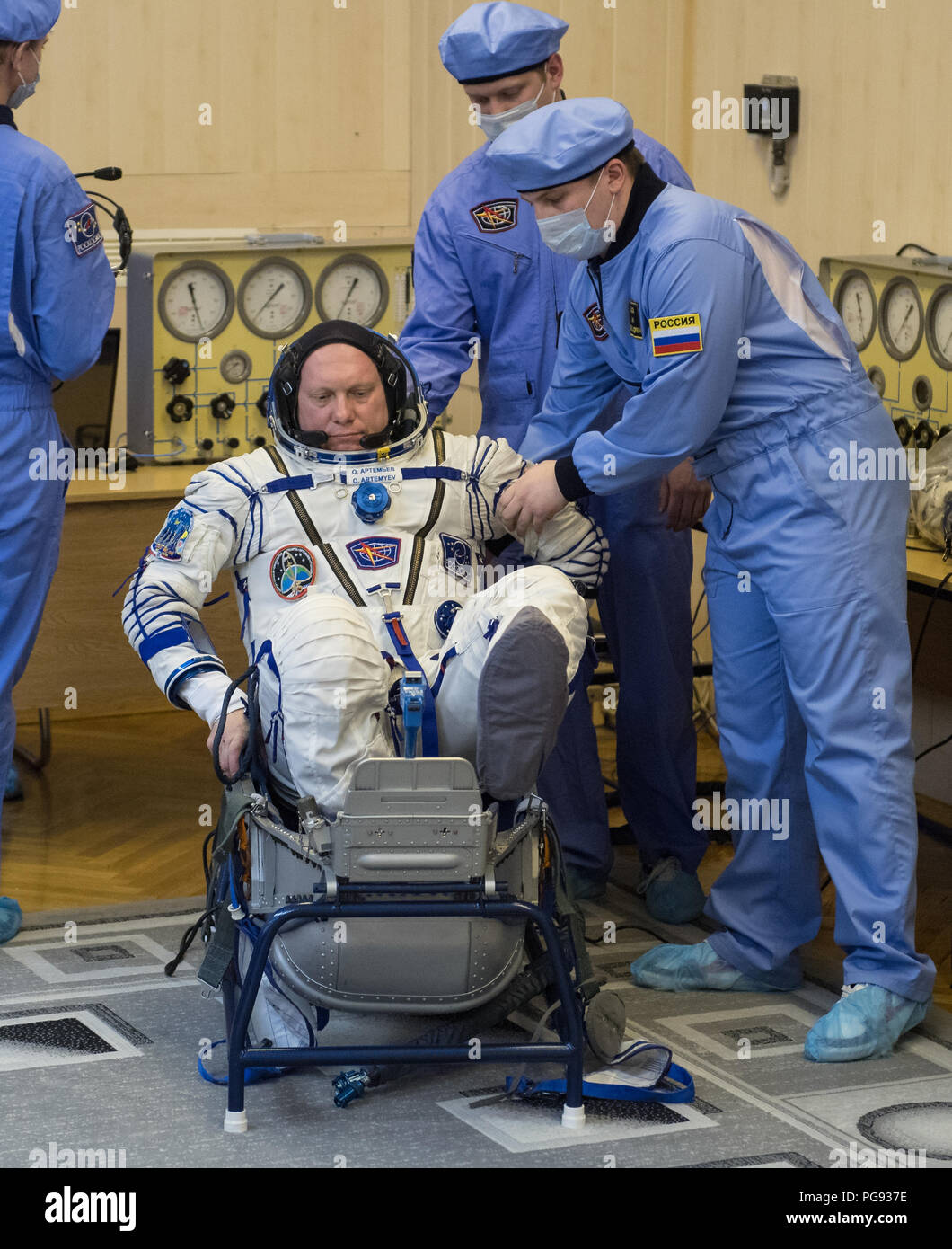 Expedition 55 Soyuz Commander Oleg Artemyev of Roscosmos prepares to have his Russian Sokol suit pressure checked in preparation for launch aboard the Soyuz MS-08 spacecraft, Wednesday, March 21, 2018 at the Baikonur Cosmodrome in Kazakhstan. Artemyev and flight engineers Ricky Arnold and Drew Feustel of NASA launched aboard the Soyuz MS-08 spacecraft at 1:44 p.m. Eastern time (11:44 p.m. Baikonur time) on March 21 to begin their journey to the International Space Station. - Stock Image