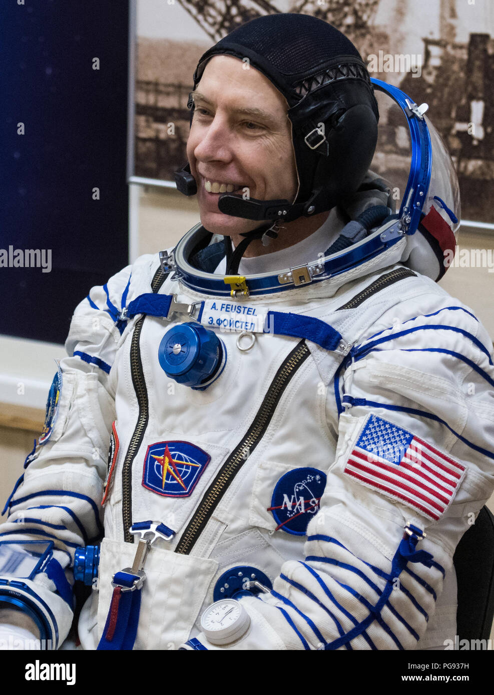Expedition 55 flight engineer Drew Feustel of NASA  is seen as he waits to have his Russian Sokol suit pressure checked in preparation for launch aboard the Soyuz MS-08 spacecraft, Wednesday, March 21, 2018 at the Baikonur Cosmodrome in Kazakhstan. Feustel, Soyuz Commander Oleg Artemyev of Roscosmos, and flight engineer Ricky Arnold of NASA launched aboard the Soyuz MS-08 spacecraft at 1:44 p.m. Eastern time (11:44 p.m. Baikonur time) on March 21 to begin their journey to the International Space Station. - Stock Image