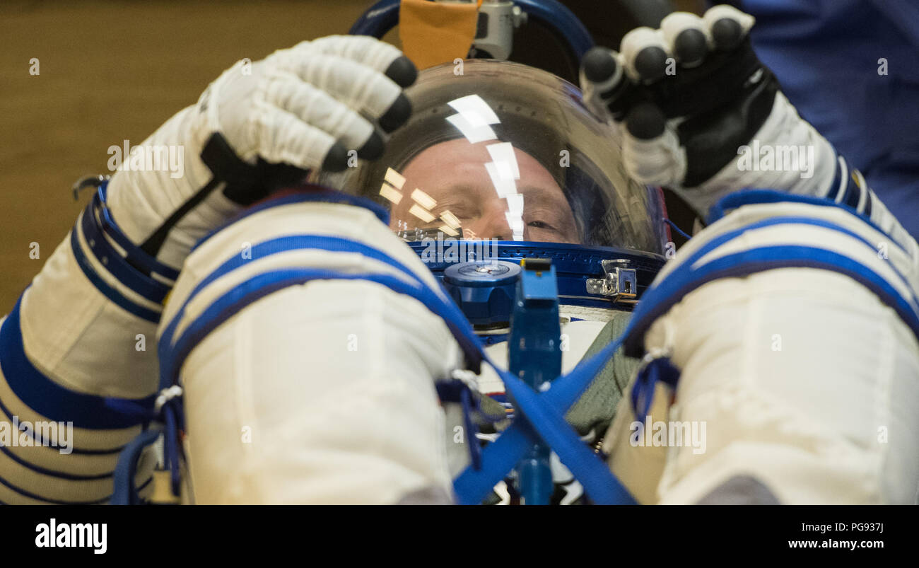 Expedition 55 Soyuz Commander Oleg Artemyev of Roscosmos has his Russian Sokol suit pressure checked in preparation for launch aboard the Soyuz MS-08 spacecraft, Wednesday, March 21, 2018 at the Baikonur Cosmodrome in Kazakhstan. Artemyev and flight engineers Ricky Arnold and Drew Feustel of NASA launched aboard the Soyuz MS-08 spacecraft at 1:44 p.m. Eastern time (11:44 p.m. Baikonur time) on March 21 to begin their journey to the International Space Station. - Stock Image