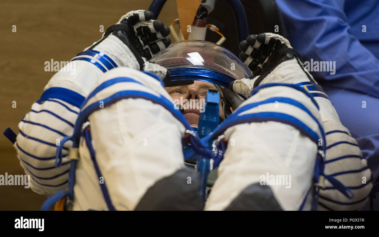 Expedition 55 flight engineer Drew Feustel of NASA prepares to have his Russian Sokol suit pressure checked in preparation for launch aboard the Soyuz MS-08 spacecraft, Wednesday, March 21, 2018 at the Baikonur Cosmodrome in Kazakhstan. Feustel, Soyuz Commander Oleg Artemyev of Roscosmos, and flight engineer Ricky Arnold of NASA launched aboard the Soyuz MS-08 spacecraft at 1:44 p.m. Eastern time (11:44 p.m. Baikonur time) on March 21 to begin their journey to the International Space Station. - Stock Image