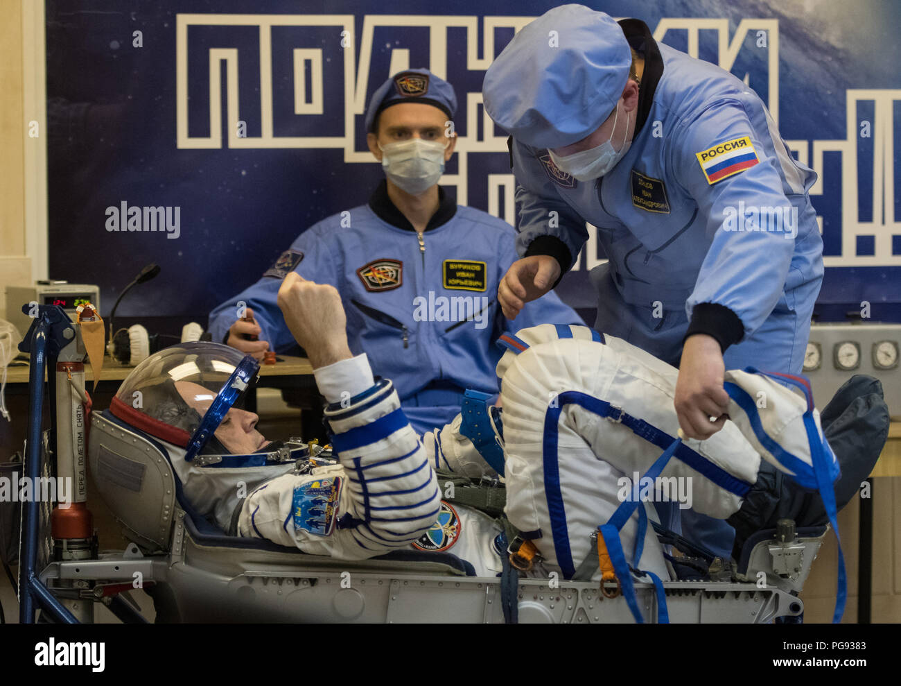 Expedition 55 flight engineer Ricky Arnold of NASA prepares to have his Russian Sokol suit pressure checked in preparation for launch aboard the Soyuz MS-08 spacecraft, Wednesday, March 21, 2018 at the Baikonur Cosmodrome in Kazakhstan. Arnold, Soyuz Commander Oleg Artemyev of Roscosmos, and flight engineer Drew Feustel of NASA launched aboard the Soyuz MS-08 spacecraft at 1:44 p.m. Eastern time (11:44 p.m. Baikonur time) on March 21 to begin their journey to the International Space Station. - Stock Image