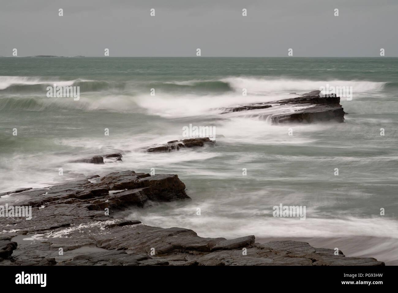 Breaking waves at Spanish Point on the west coast of Ireland - Stock Image