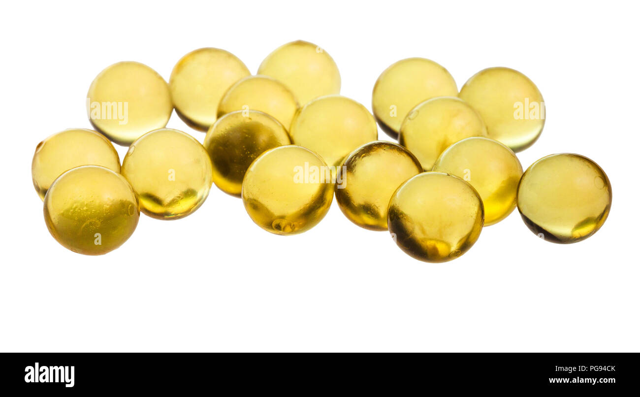 many capsules with oil (Milk thistle extract) close up isolated on white background - Stock Image