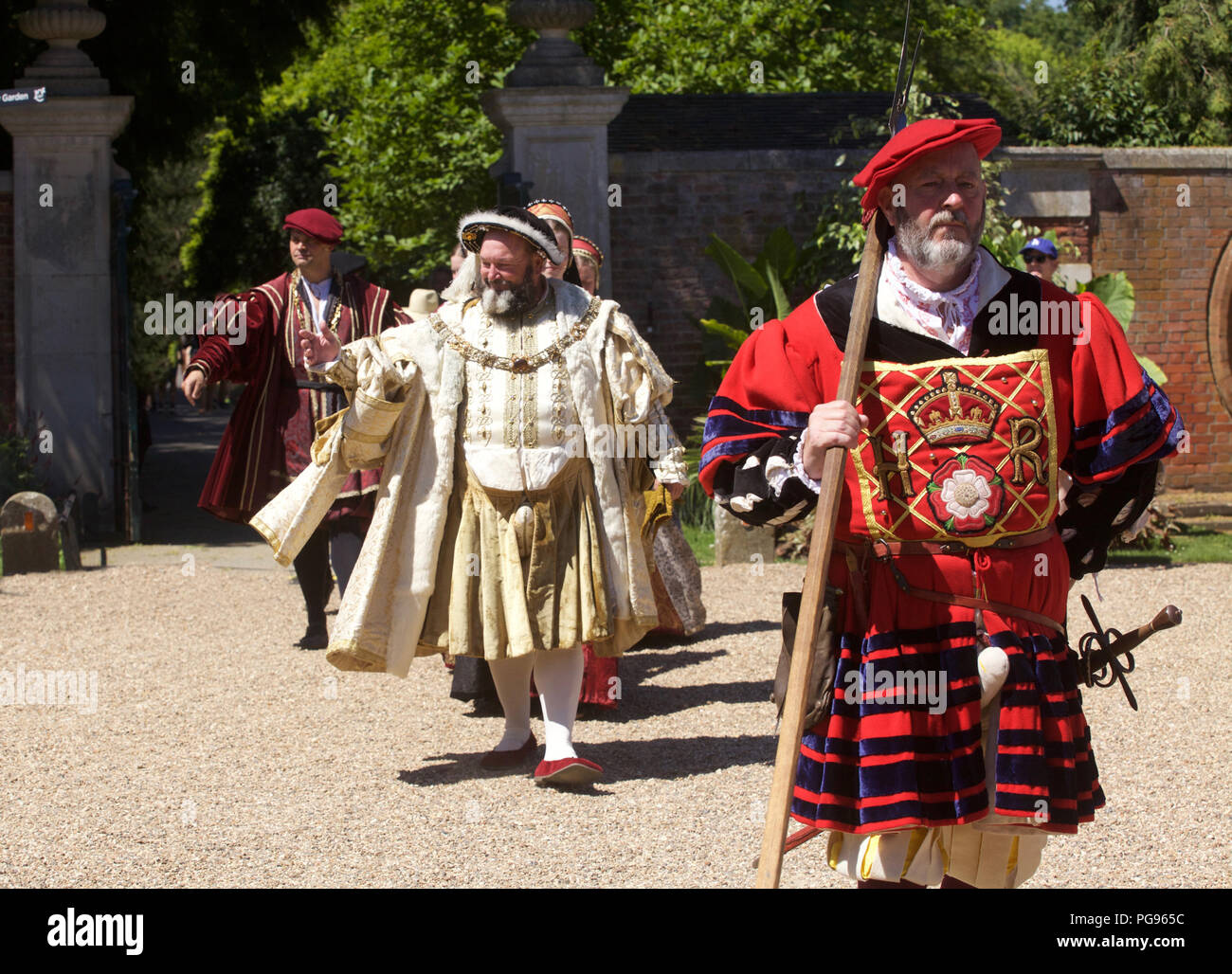 KIng Henry Eigth and courtiers (played by actors at Hamton Court Place London) Stock Photo