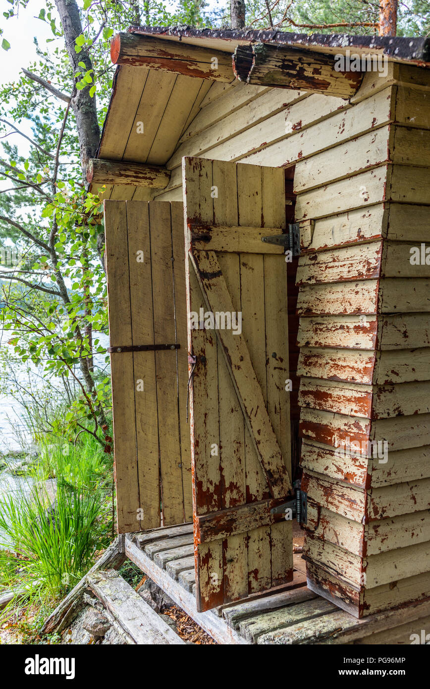 Deatil of an old wooden changing cabin on the shore of the Saimaa lake in Finland - 4 Stock Photo
