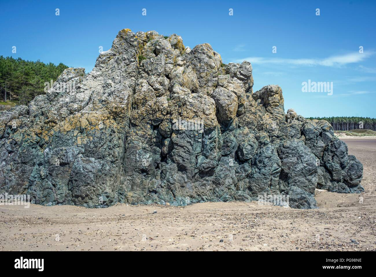 Basaltic pillow lava formed from underwater volcanic activity between 500 and 600 million years ago. Photographed at Newborough Sands, Anglesey, Wales, UK. Stock Photo