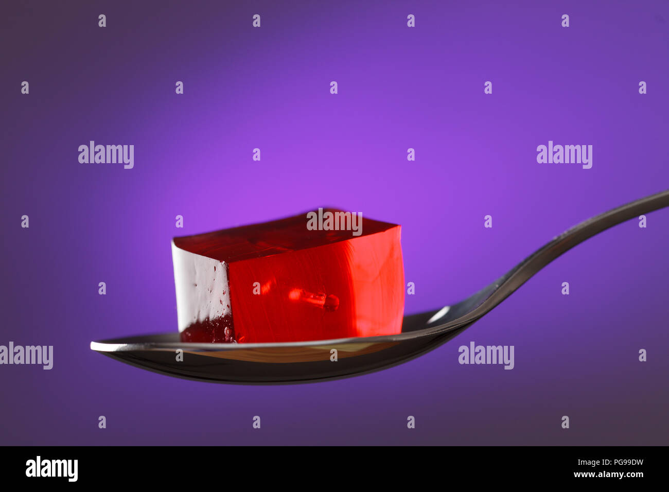 Fruit jelly on a spoon - Stock Image