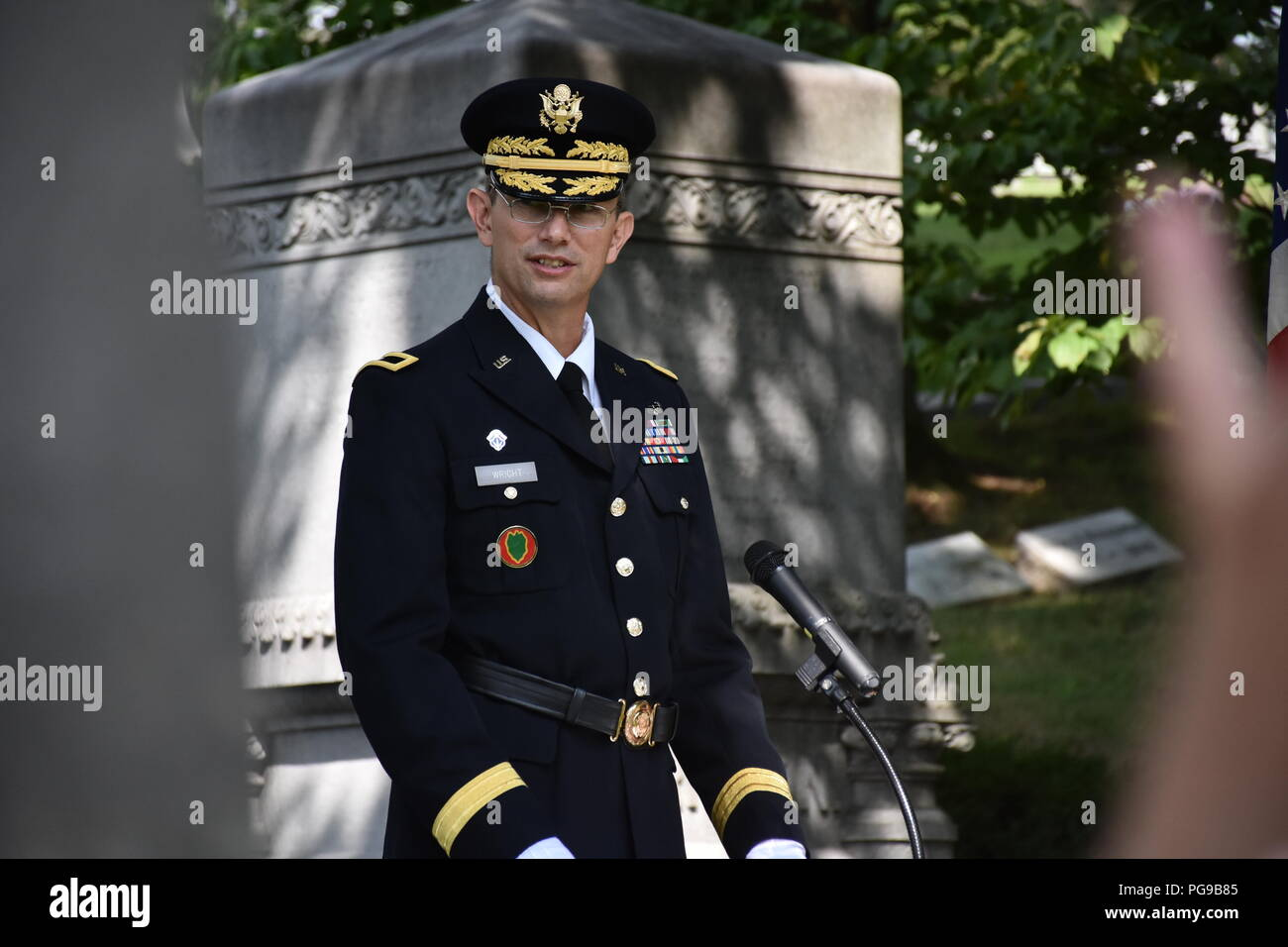 Brigadier Gen. Tony L. Wright, 88th Readiness Division deputy commanding general, speaks during at a wreath laying ceremony for President Benjamin Harrison at Crown Hill Cemetery, in Indianapolis, on Aug. 18, to commemorate the Hoosier President's 185th birthday. (US Army photo by Catherine Carroll) Stock Photo