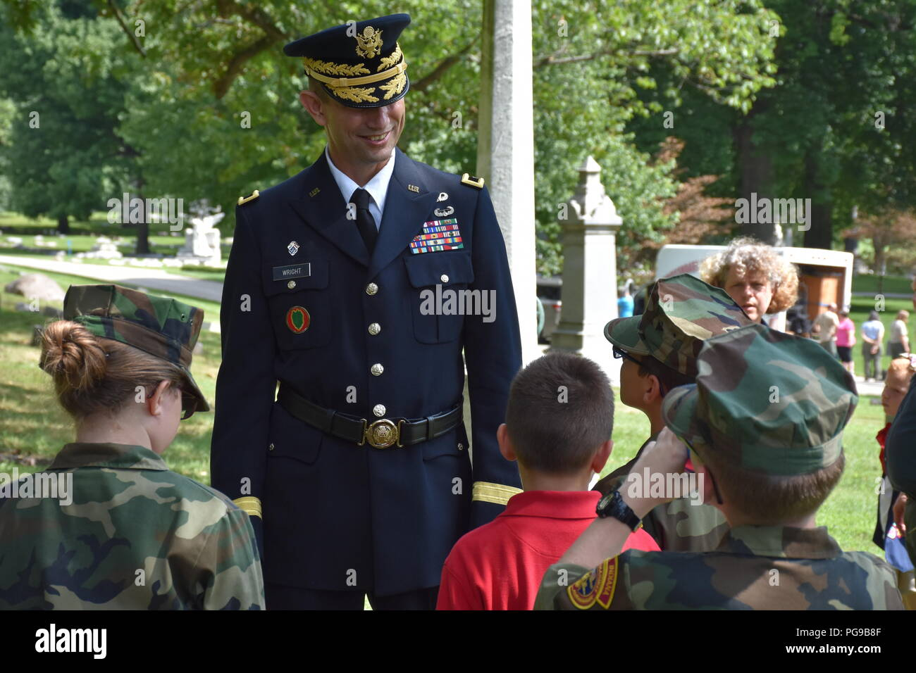 Brigadier Gen. Tony L. Wright, 88th Readiness Division deputy commanding general, answers questions from members of the Central Indiana Young Marines following a wreath laying ceremony for President Benjamin Harrison at Crown Hill Cemetery, in Indianapolis, on Aug. 18, to commemorate the Hoosier President's 185th birthday. (US Army photo by Catherine Carroll) Stock Photo