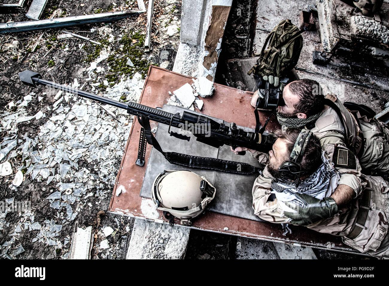 Commando sniper team in ambush during city fight Stock Photo