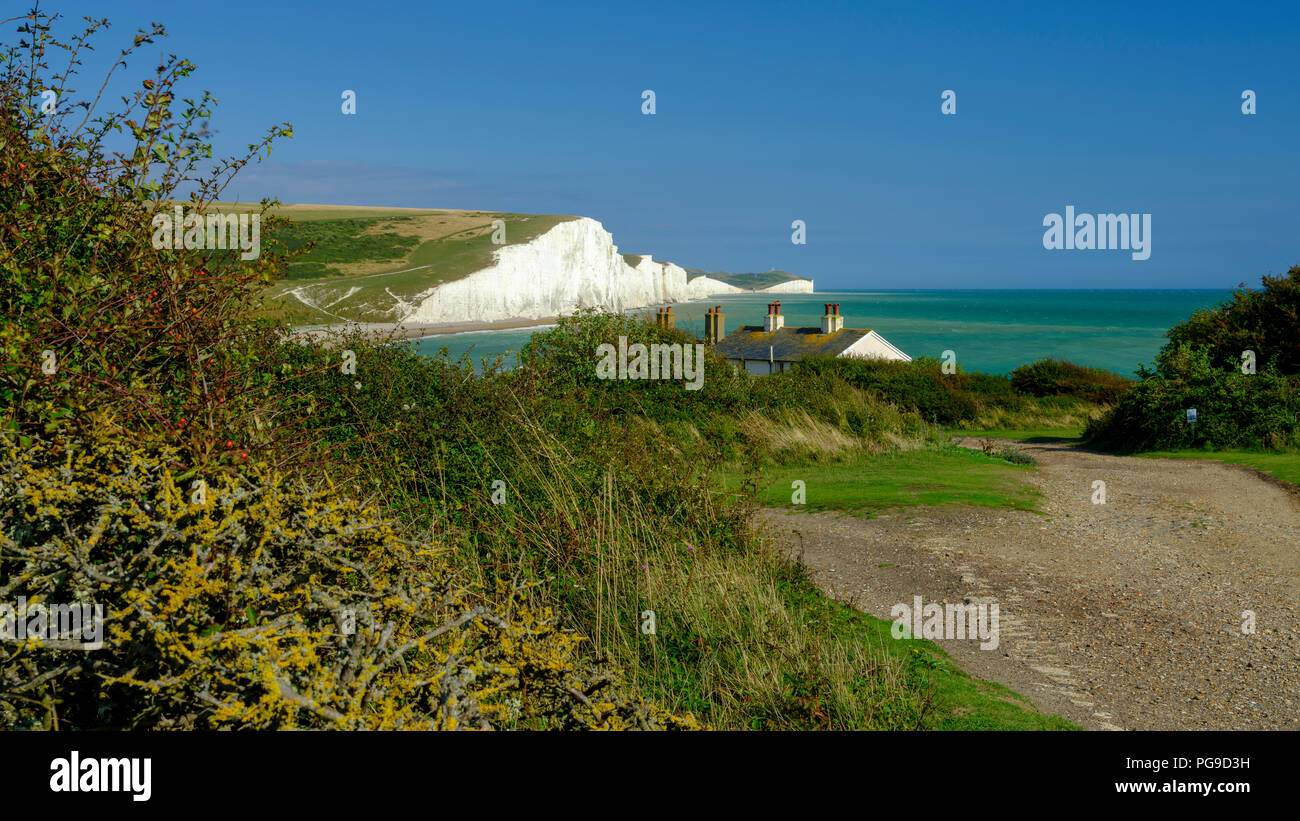 Summer afternoon light on the Severn Sisters white cliffs and the Coast Guard cottages at Cuckmere, in the South Downs National Park, East Sussex, UK Stock Photo