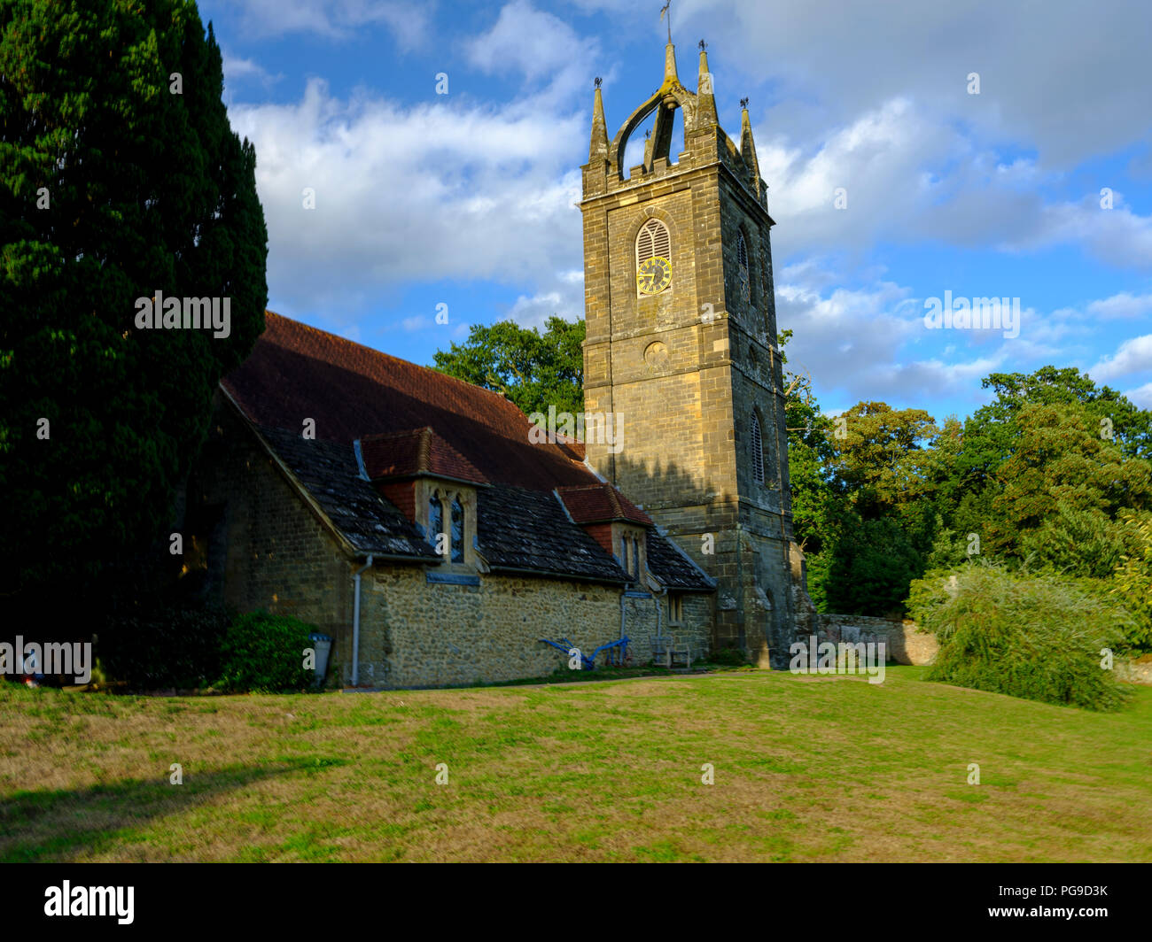 Late afternoon summer light on All Hallow's Church at Tillington next to the Petworth Estate in the South Downs National Park, West Sussex, UK Stock Photo