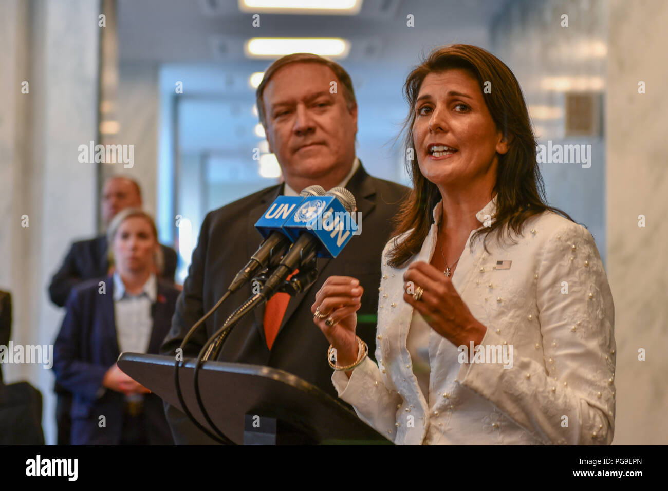 U.S. Permanent Representative to the United Nations Nikki Haley flanked by U.S. Secretary of State Michael R. Pompeo addresses the press in New York, New York on July 20, 2018. - Stock Image