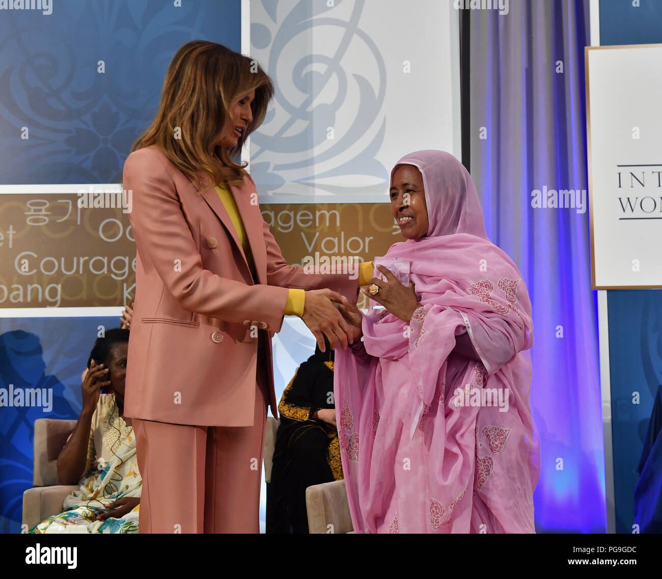 First Lady of the United States Melania Trump presents the 2018 International Women of Courage (IWOC) Award to L'Malouma Said of Mauritania during a ceremony at the U.S. Department of State in Washington, D.C. on March 23, 2018. Stock Photo