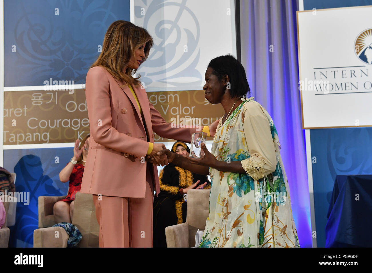 First Lady of the United States Melania Trump presents the 2018 International Women of Courage (IWOC) Award to Godelive Mukasarasi of Rwanda during a ceremony at the U.S. Department of State in Washington, D.C. on March 23, 2018. Stock Photo