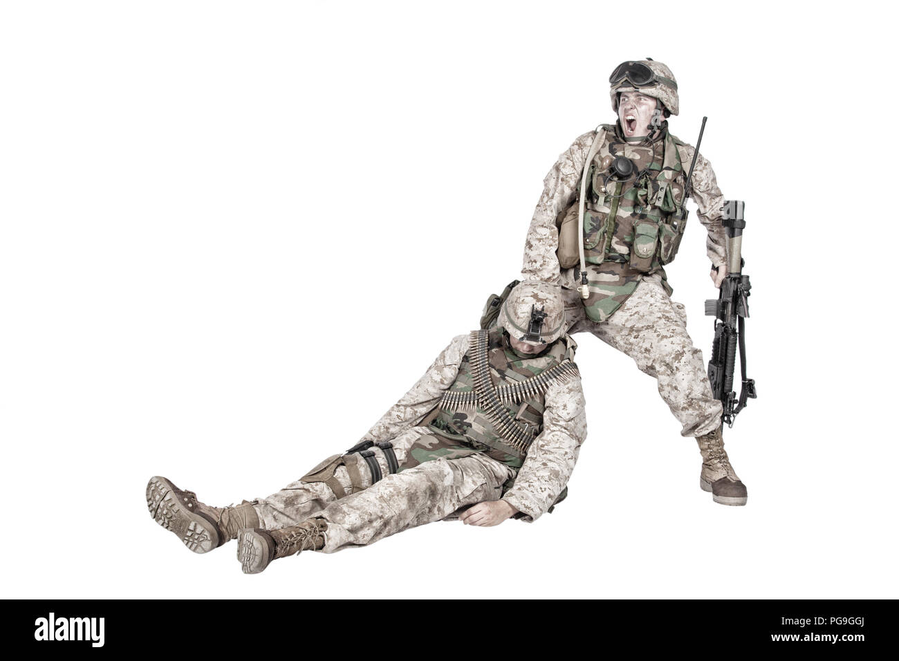 Wounded commando evacuating fellow soldier from battlefield - Stock Image