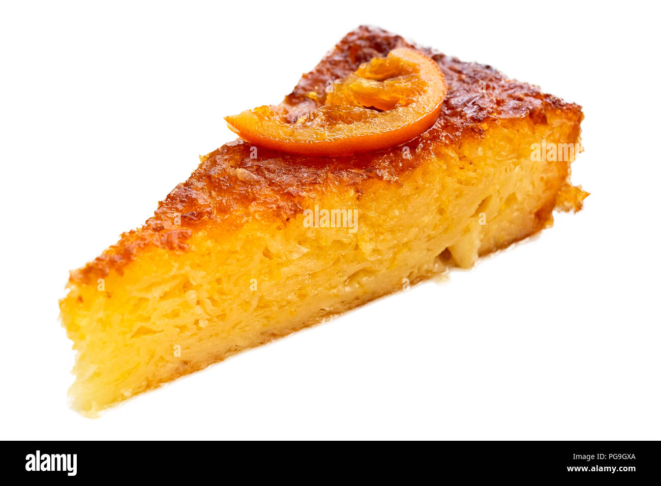 A piece of traditional greek orange cake isolated on white. Stock Photo