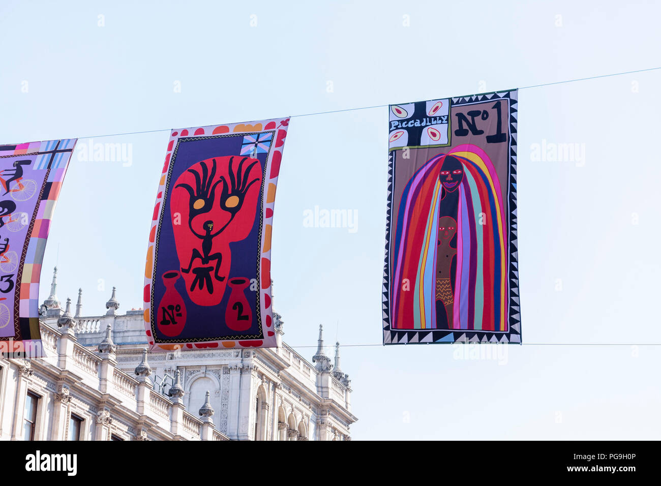 Artwork by Grayson Perry hanging outside the Royal Academy furing their Summer Exhibition. London, 2018 - Stock Image