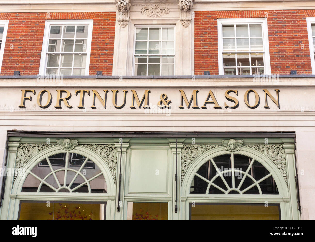 Exterior of famous department store with signage, Fortnum & Mason, in Piccadilly, London, UK - Stock Image